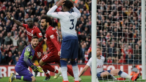 <p>               Liverpool's Mohamed Salah, center, celebrates after Tottenham's Toby Alderweireld scores an own goal past his goalkeeper during the English Premier League soccer match between Liverpool and Tottenham Hotspur at Anfield stadium in Liverpool, England, Sunday, March 31, 2019. (AP Photo/Rui Vieira)             </p>