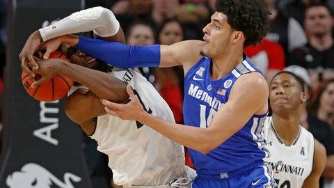 <p>               Memphis forward Isaiah Maurice, right, battles Cincinnati forward Eliel Nsoseme (22) for a rebound during the first half of an NCAA college basketball game Saturday, March 2, 2019, in Cincinnati. (AP Photo/Gary Landers)             </p>
