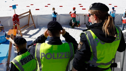 <p>               Austrian Federal Police officers stand at the finish area of a men's cross country skiing 15km classic competition, at the Nordic Ski World Championships, in Seefeld, Austria, Wednesday, Feb. 27, 2019. Austrian authorities say five elite athletes and four others have been arrested in doping raids in the country and neighboring Germany amid the Nordic skiing world championships. (AP Photo/Matthias Schrader)             </p>