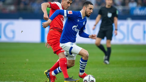 <p>               Duesseldorf's Aymen Barkok, left, and Schalke's Nabil Bentaleb, right, challenge for the ball during the German Bundesliga soccer match between FC Schalke 04 and Fortuna Duesseldorf in Gelsenkirchen, Germany, Saturday, March 2, 2019. (Guido Kirchner/dpa via AP)             </p>