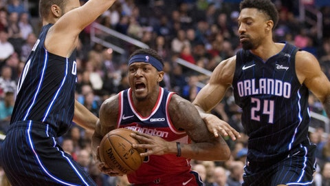 <p>               Washington Wizards guard Bradley Beal, center, drives between Orlando Magic guard Evan Fournier, from France, and center Khem Birch during the second half of an NBA basketball game Wednesday, March 13, 2019, in Washington. The Wizards won 100-90. (AP Photo/Alex Brandon)             </p>