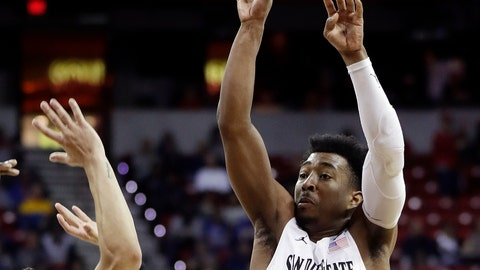 <p>               San Diego State's Devin Watson shoots during the first half of an NCAA college basketball game against UNLV in the Mountain West Conference men's tournament Thursday, March 14, 2019, in Las Vegas. (AP Photo/Isaac Brekken)             </p>