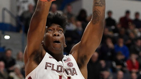 <p>               Florida State's Terance Mann (14) dunks the ball during the first half of a second round men's college basketball game against Murray State in the NCAA tournament, Saturday, March 23, 2019, in Hartford, Conn. (AP Photo/Jessica Hill)             </p>