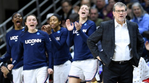 <p>               Connecticut head coach Geno Auriemma, right, leads his team from the sideline during a first round women's college basketball game against Towson in the NCAA Tournament, Friday, March 22, 2019, in Storrs, Conn. (AP Photo/Stephen Dunn)             </p>