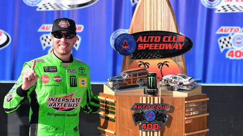 FONTANA, CALIFORNIA - MARCH 17: Kyle Busch, driver of the #18 Interstate Batteries Toyota, celebrates in victory lane after winning the Monster Energy NASCAR Cup Series Auto Club 400 and winning his 200th NASCAR race at Auto Club Speedway on March 17, 2019 in Fontana, California. (Photo by Jared C. Tilton/Getty Images)