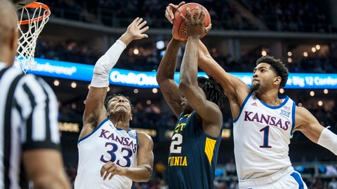 Mar 15, 2019; Kansas City, MO, USA; Kansas Jayhawks forward David McCormack (33) and forward Dedric Lawson (1) defend a shot by West Virginia Mountaineers forward Andrew Gordon (12) during the second half of the semifinals of the Big 12 conference tournament at Sprint Center. Mandatory Credit: Amy Kontras-USA TODAY Sports
