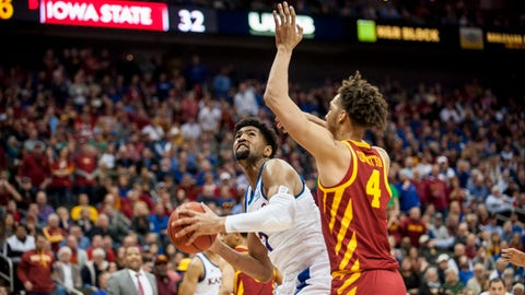 Mar 16, 2019; Kansas City, MO, USA; Iowa State Cyclones forward George Conditt IV (4) guards Kansas Jayhawks forward Dedric Lawson (1) during the first half of the final of the Big 12 conference tournament at Sprint Center. Mandatory Credit: Amy Kontras-USA TODAY Sports