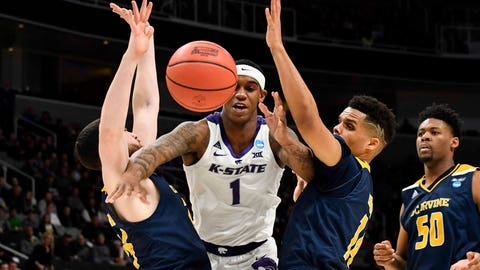 Mar 22, 2019; San Jose, CA, USA; Kansas State Wildcats guard Shaun Neal-Williams (1) loses control of the ball as UC Irvine Anteaters guard Spencer Rivers (25) and guard Evan Leonard (14) defend during the first half in the first round of the 2019 NCAA Tournament at SAP Center. Mandatory Credit: Kelley L Cox-USA TODAY Sports