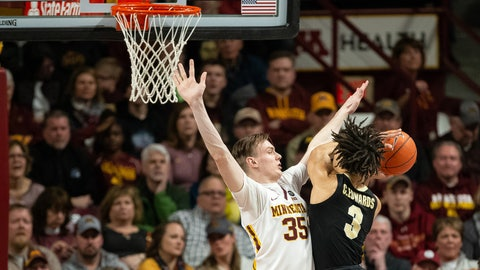 Mar 5, 2019; Minneapolis, MN, USA; Minnesota Gophers center Matz Stockman (35) fouls Purdue Boilermakers guard Carsen Edwards (3) during the first half at Williams Arena. Mandatory Credit: Harrison Barden-USA TODAY Sports