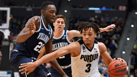 Purdue's Carsen Edwards, right, dribbles around Villanova's Dhamir Cosby-Roundtree, left and Villanova's Collin Gillespie, back, during the second half of a second round men's college basketball game in the NCAA tournament, Saturday, March 23, 2019, in Hartford, Conn. (AP Photo/Jessica Hill)