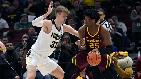 Mar 15, 2019; Chicago, IL, USA; Minnesota Golden center Daniel Oturu (25) is defended by Purdue Boilermakers center Matt Haarms (32) during the second half in the Big Ten conference tournament at United Center. Mandatory Credit: David Banks-USA TODAY Sports