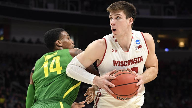 Run for Happ, Badgers ends with 72-54 loss to Oregon