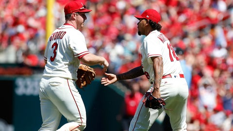 Jun 10, 2017; St. Louis, MO, USA; St. Louis Cardinals starting pitcher Carlos Martinez (18) congratulates third baseman Jedd Gyorko (3) after Gyorko made the final out of the in the seventh inning against the Philadelphia Phillies at Busch Stadium. Mandatory Credit: Scott Kane-USA TODAY Sports