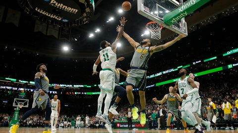 Mar 29, 2019; Boston, MA, USA; Boston Celtics guard Kyrie Irving (11) drives to the basket for the game winning shot against the Indiana Pacers in the second half at TD Garden. Celtics defaced the Pacers 114-112.Mandatory Credit: David Butler II-USA TODAY Sports
