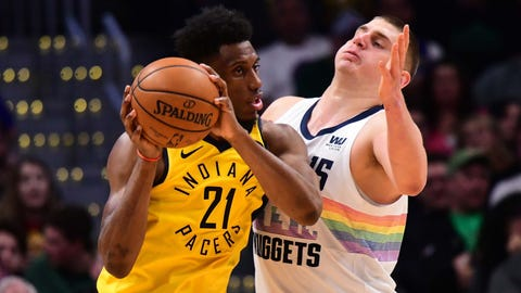 Mar 16, 2019; Denver, CO, USA; Indiana Pacers forward Thaddeus Young (21) and Denver Nuggets center Nikola Jokic (15) during the second quarter at the Pepsi Center. Mandatory Credit: Ron Chenoy-USA TODAY Sports