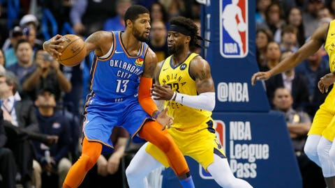 Mar 27, 2019; Oklahoma City, OK, USA; Oklahoma City Thunder forward Paul George (13) drives to the basket as Indiana Pacers guard Wesley Matthews (23) defends during the first quarter at Chesapeake Energy Arena. Mandatory Credit: Alonzo Adams-USA TODAY Sports