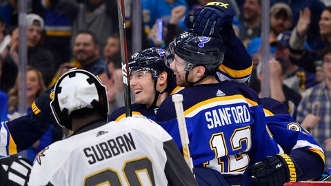 Mar 25, 2019; St. Louis, MO, USA; St. Louis Blues left wing Zach Sanford (12) celebrates with teammates after scoring against Vegas Golden Knights goaltender Malcolm Subban (30) during the third period at Enterprise Center. Mandatory Credit: Jeff Curry-USA TODAY Sports