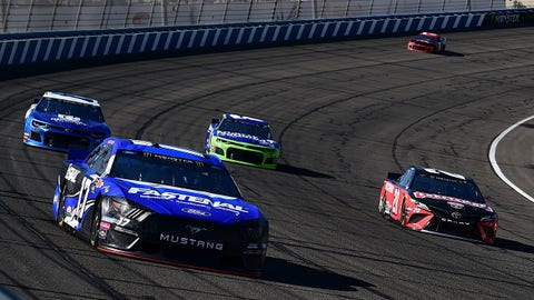 FONTANA, CA - MARCH 15:  Ricky Stenhouse Jr, driver of the #17 Fastenal Ford, Erik Jones, driver of the #20 Craftsman Toyota, and Matt DiBenedetto, driver of the #95 Procore Toyota, lead a pack of cars during qualifying for the Monster Energy NASCAR Cup Series Auto Club 400 at Auto Club Speedway on March 15, 2019 in Fontana, California.  (Photo by Jared C. Tilton/Getty Images)