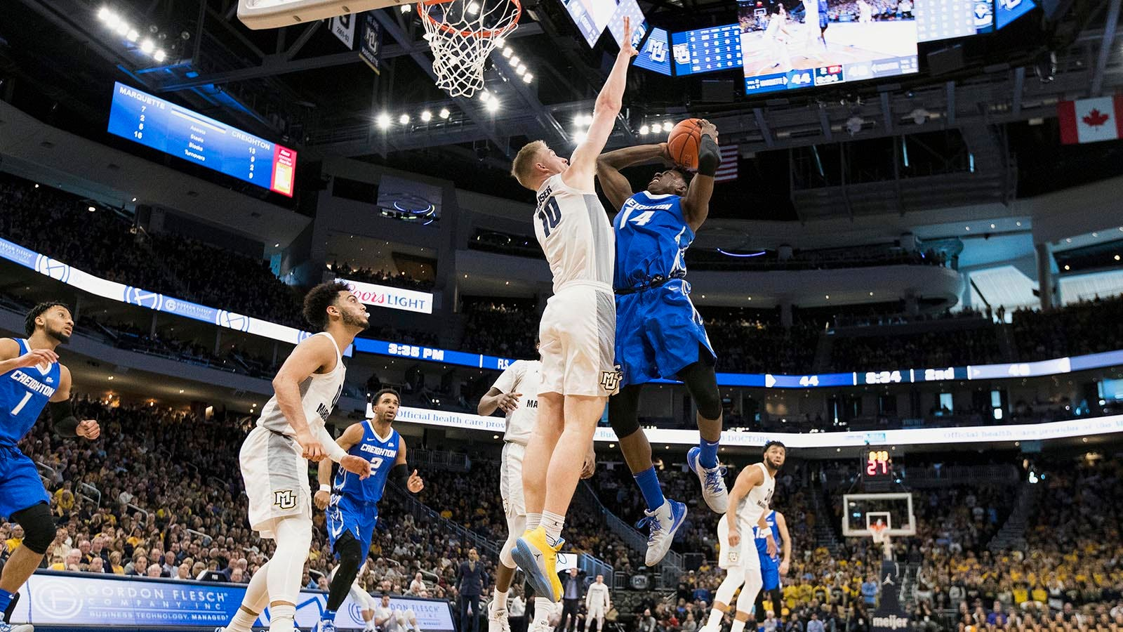Marquette falls to No  16, Wisconsin to No  21 in latest AP poll