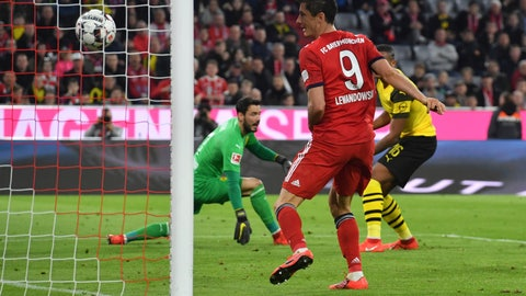 <p>               Bayern's Robert Lewandowski scores his side's fifth goal during the German Bundesliga soccer match between FC Bayern Munich and Borussia Dortmund in the Allianz Arena in Munich, Germany, on Saturday, April 6, 2019. Bayern won 5-0. (AP Photo/Kerstin Joensson)             </p>