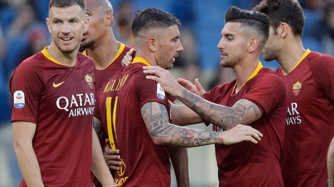 <p>               Roma's Aleksandar Kolarov, center, celebrates with his teammates after he scored his side's third goal during a Serie A soccer match between Roma and Cagliari, at Rome's Olympic Stadium, Saturday, April 27, 2019. (AP Photo/Gregorio Borgia)             </p>