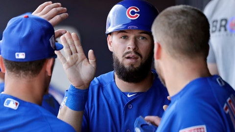 <p>               Chicago Cubs' David Bote is congratulated after scoring against the San Diego Padres in the fourth inning of a spring training baseball game Sunday, March 24, 2019, in Peoria, Ariz. (AP Photo/Elaine Thompson)             </p>