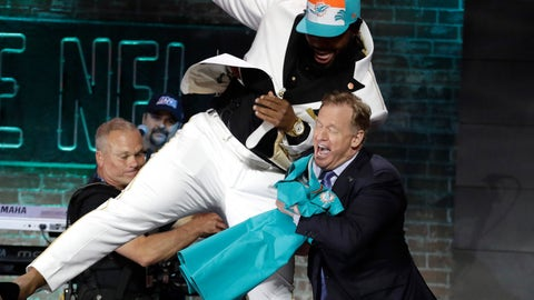 <p>               Clemson defensive tackle Christian Wilkins moves into NFL Commissioner Roger Goodell after the Miami Dolphins selected Wilkins in the first round at the NFL football draft, Thursday, April 25, 2019, in Nashville, Tenn.(AP Photo/Steve Helber)             </p>