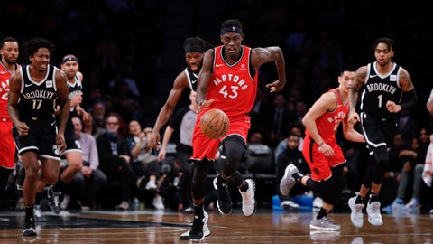 <p>               Toronto Raptors forward Pascal Siakam, center, dribbles the ball down court during the first half of an NBA basketball game Wednesday, April 3, 2019, in New York. (AP Photo/Kevin Hagen)             </p>