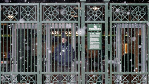 <p>               A security guard looks to outside from Wrigley Field, Sunday, April 14, 2019, in Chicago. The Chicago Cubs baseball game against the Los Angeles Angels was postponed due to inclement weather. The makeup date is yet to be determined. (AP Photo/Nam Y. Huh)             </p>