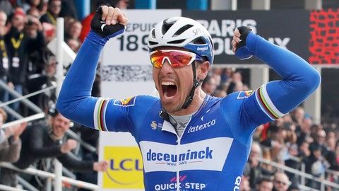 <p>               Philippe Gilbert of Belgium celebrates as he crosses the finish line to win the 117th edition of the Paris-Roubaix cycling classic, a 257 kilometer (160 mile) one-day-race, with about 20 per cent of the distance over cobblestone roads, at the velodrome in Roubaix, northern France, Sunday, April 14, 2019. (AP Photo/Christophe Ena )             </p>