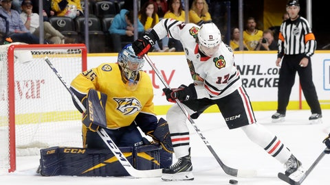 <p>               Chicago Blackhawks center Dylan Strome (17) tries to get a shot away in front of Nashville Predators goaltender Pekka Rinne (35), of Finland, during the first period of an NHL hockey game Saturday, April 6, 2019, in Nashville, Tenn. (AP Photo/Mark Humphrey)             </p>