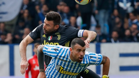 <p>               Juventus' Andrea Barzagli, top, and Spal's Andrea Petagna vie for the ball during the Serie A soccer match between Spal and Juventus, at the Paolo Mazza stadium in Ferrara, Italy, Saturday, April 13, 2019. (AP Photo/Antonio Calanni)             </p>