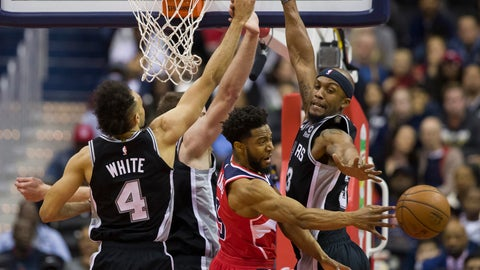 <p>               Washington Wizards guard Chasson Randle passes the ball between San Antonio Spurs guard Derrick White, left, center Jakob Poeltl, from Austria, and forward Dante Cunningham, right, during the first half of an NBA basketball game Friday, April 5, 2019, in Washington. (AP Photo/Alex Brandon)             </p>