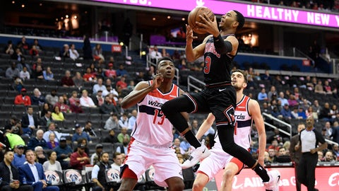 <p>               Chicago Bulls guard Shaquille Harrison (3) goes to the basket against Washington Wizards center Thomas Bryant (13) and Tomas Satoransky, right, during the first half of an NBA basketball game, Wednesday, April 3, 2019, in Washington. (AP Photo/Nick Wass)             </p>