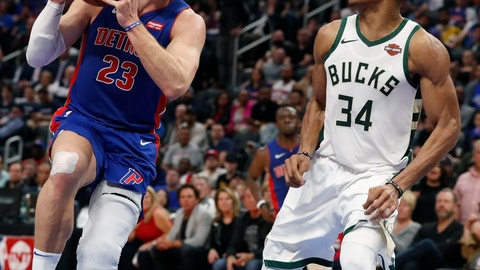 <p>               Detroit Pistons forward Blake Griffin (23) attempts a layup as Milwaukee Bucks forward Giannis Antetokounmpo (34) defends during the second half of Game 4 of a first-round NBA basketball playoff series, Monday, April 22, 2019, in Detroit. (AP Photo/Carlos Osorio)             </p>
