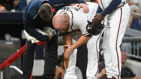<p>               Atlanta Braves catcher Brian McCann is tended to by trainer Mike Frostad, left, after being thrown out sliding into third base by Miami Marlins catcher Jorge Alfaro on a bunt by Kyle Wright during the fifth inning of a baseball game against the Miami Marlins, Saturday, April 6, 2019, in Atlanta. (AP Photo/John Amis)             </p>