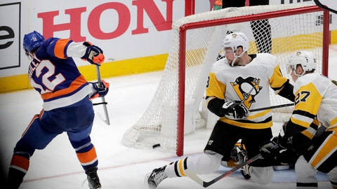 <p>               New York Islanders right wing Josh Bailey (12) scores during overtime of Game 1 of an NHL hockey first-round playoff series against the Pittsburgh Penguins, Wednesday, April 10, 2019, in Uniondale, N.Y. The Islanders won 4-3. (AP Photo/Julio Cortez)             </p>