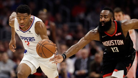 <p>               Los Angeles Clippers' Shai Gilgeous-Alexander, left, dribbles past Houston Rockets' James Harden (13) during the first half of an NBA basketball game Wednesday, April 3, 2019, in Los Angeles. (AP Photo/Marcio Jose Sanchez)             </p>