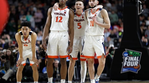 <p>               Virginia players Kihei Clark, from left, De'Andre Hunter, Kyle Guy and Ty Jerome celebrate at the end of the championship game against Texas Tech in the Final Four NCAA college basketball tournament, Monday, April 8, 2019, in Minneapolis. Virginia won 85-77 in overtime. (AP Photo/David J. Phillip)             </p>