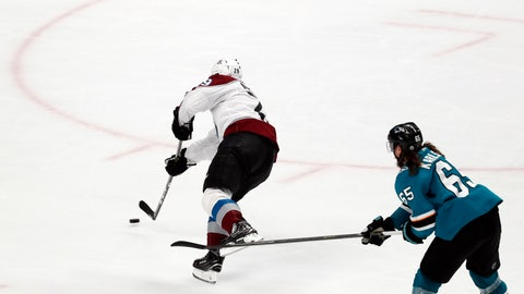 <p>               Colorado Avalanche's Nathan MacKinnon (29) shoots to score a goal against San Jose Sharks' Erik Karlsson (65) in the third period of Game 2 of an NHL hockey second-round playoff series at the SAP Center in San Jose, Calif., on Sunday, April 28, 2019. (AP Photo/Josie Lepe)             </p>