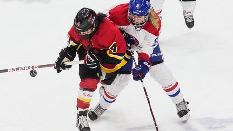 <p>               FILE - In this Sunday, March 24, 2019, file photo, Calgary Inferno's Brigette Lacquette, left, battles for the puck with Les Canadiennes de Montreal's Lauriane Rougeau during the second-period action of the Clarkson Cup hockey game in Toronto, Ontario. The Canadian Women's Hockey League will discontinue operations on May 1, the league announced Sunday, March 31. (Chris Young/The Canadian Press via AP, File)             </p>