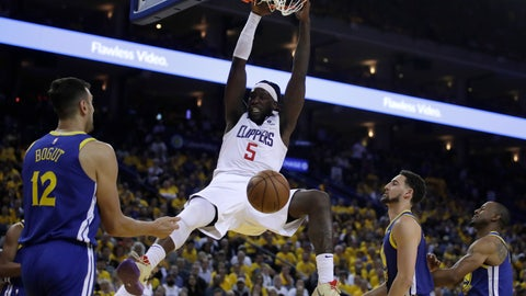 <p>               Los Angeles Clippers' Montrezl Harrell (5) scores as Golden State Warriors' Andrew Bogut (12), Klay Thompson, second from right, and Andre Iguodala watch during the second half in Game 5 of a first-round NBA basketball playoff series, Wednesday, April 24, 2019, in Oakland, Calif. (AP Photo/Ben Margot)             </p>