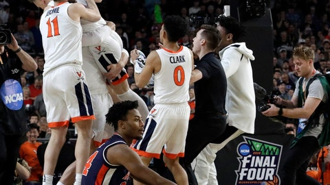 <p>               Auburn's Anfernee McLemore (24) reacts on the floor as Virginia celebrate after defeating Auburn 63-62 in the semifinals of the Final Four NCAA college basketball tournament, Saturday, April 6, 2019, in Minneapolis. (AP Photo/David J. Phillip)             </p>