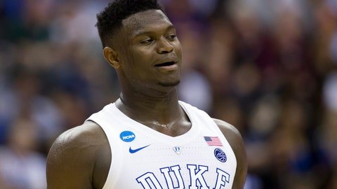 <p>               FILE - In this March 29, 2019, file photo, Duke forward Zion Williamson (1) reacts during an East Regional semifinal in the NCAA men's basketball tournamenet against Virginia Tech in Washington. Williamson was named the John R. Wooden Men's Player of the year at the College Basketball Awards ceremony in Los Angeles on Friday, April 12, 2019. (AP Photo/Alex Brandon, File)             </p>