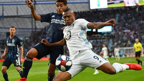 <p>               Minnesota United forward Angelo Rodriguez (9) attempts a shot while being defended by Los Angeles Galaxy midfielder Jonathan dos Santos (8) in the first half of an MLS soccer game, Wednesday, April 24, 2019, in St. Paul, Minn. (Aaron Lavinsky/Star Tribune via AP)             </p>