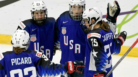 <p>               Michell Picard, Dani Cameranesi, Hilary Knight and Alex Carpenter of USA celebrate after scoring their team's first goal during the IIHF Women's Ice Hockey World Championships quarterfinal match between USA and Japan in Espoo, Finland,  Thursday, April 11, 2019. (Markku Ulander/Lehtikuva via AP)             </p>
