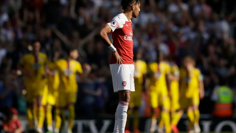 <p>               Arsenal's Pierre-Emerick Aubameyang looks on as Crystal Palace players celebrate after Wilfried Zaha scoried his side's second goal during the English Premier League soccer match between Arsenal and Crystal Palace at the Emirates Stadium in London, Sunday, April 21, 2019. (AP Photo/Tim Ireland)             </p>