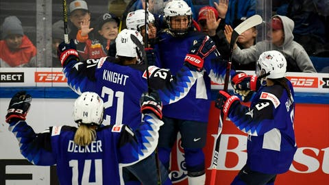 <p>               Team of USA celebrate a goal during the 2019 IIHF Women's World Championships preliminary match between USA and Canada in Espoo, Finland, Saturday April 6, 2019. (Antti Aimo-Koivisto/Lehtikuva via AP)             </p>