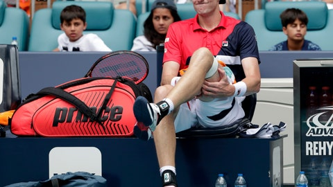 <p>               John Isner grabs his leg during a changeover during his singles final match against Roger Federer, of Switzerland, in the Miami Open tennis tournament, Sunday, March 31, 2019, in Miami Gardens, Fla. Federer won 6-1, 6-4. (AP Photo/Lynne Sladky)             </p>