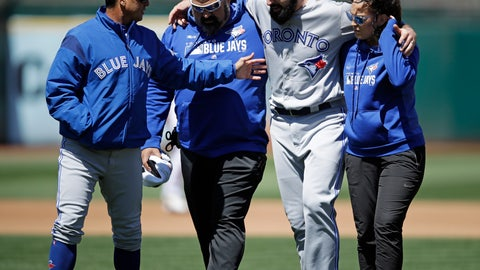 <p>               Toronto Blue Jays manager Charlie Montoyo, left, speaks with pitcher Matt Shoemaker, second from right, as Shoemaker is helped off the field after sustaining an injury during a rundown play against the Oakland Athletics in the third inning of a baseball game Saturday, April 20, 2019, in Oakland, Calif. (AP Photo/Ben Margot)             </p>